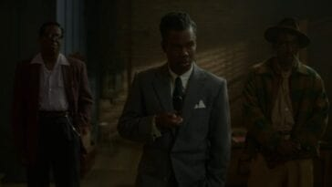 Chris Rock in a suit in Fargo Season 4, with a man to each side