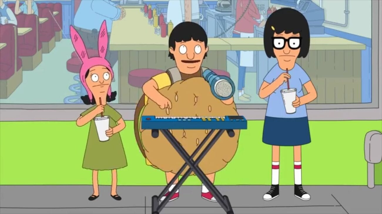 """The Belcher children from Bob's Burgers perform the song """"I Want Some Burgers and Fries"""" outside the restaurant. Gene is standing in the middle, playing his keyboard, singing into a megaphone, and dressed up in a burger costume. Tina and Louise flank him playing straws."""