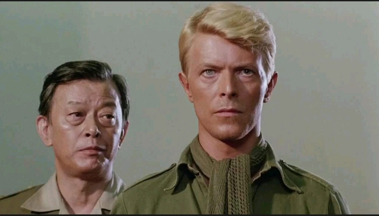 A medium show of Major Celliers (David Bowie) as a Japanese military legal defense stands beside him