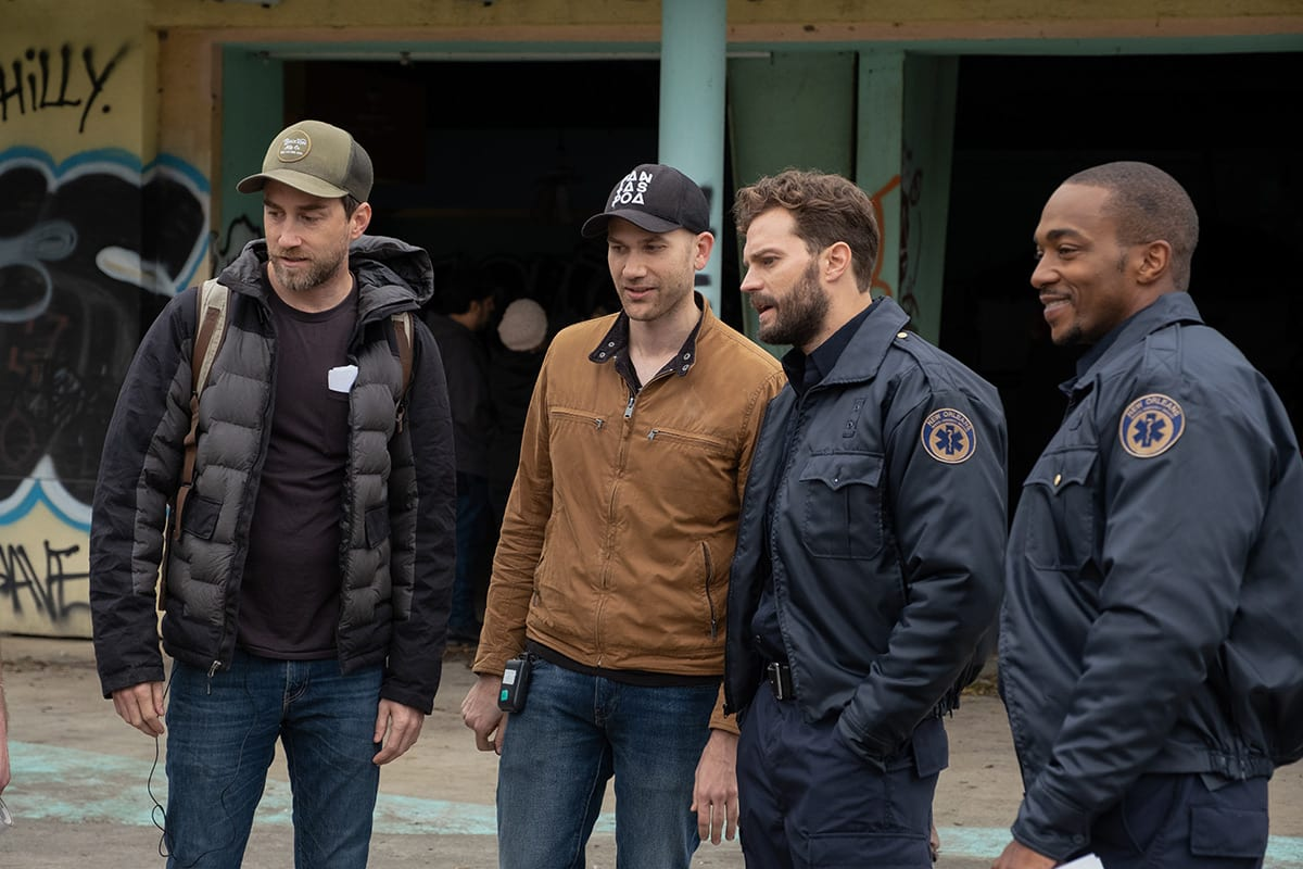 Justin Benson and Aaron Moorhead on set with Anthony Mackie, Jamie Dornan in their uniforms