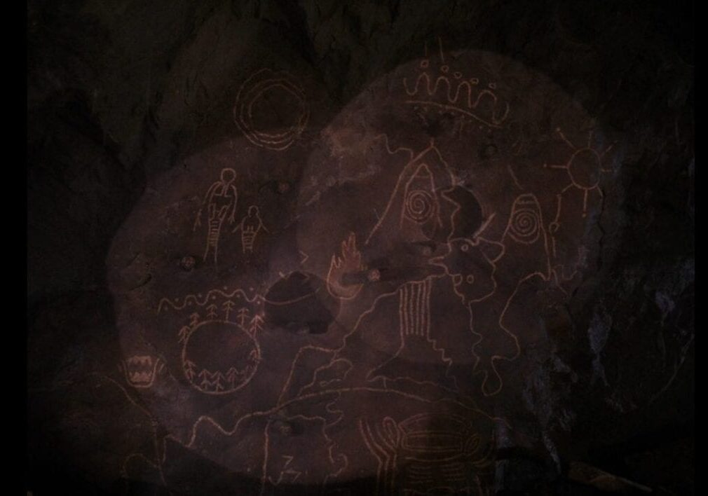 Two flashlights focus on the map in the Owl Cave