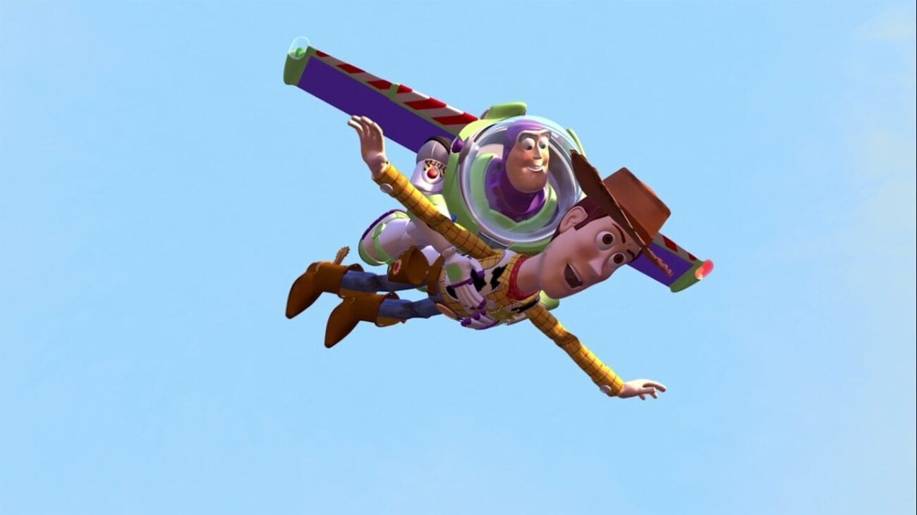 "Buzz holds Woody while they fly or ""fall with style"" in the film's iconic climax"