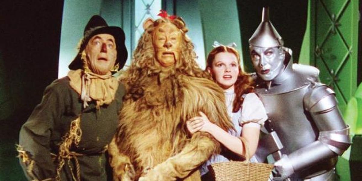 The Scarecrow, Cowardly Lion, Dorothy and the Tin Man huddled together in a green room, about to meet the powerful Wizard of Oz