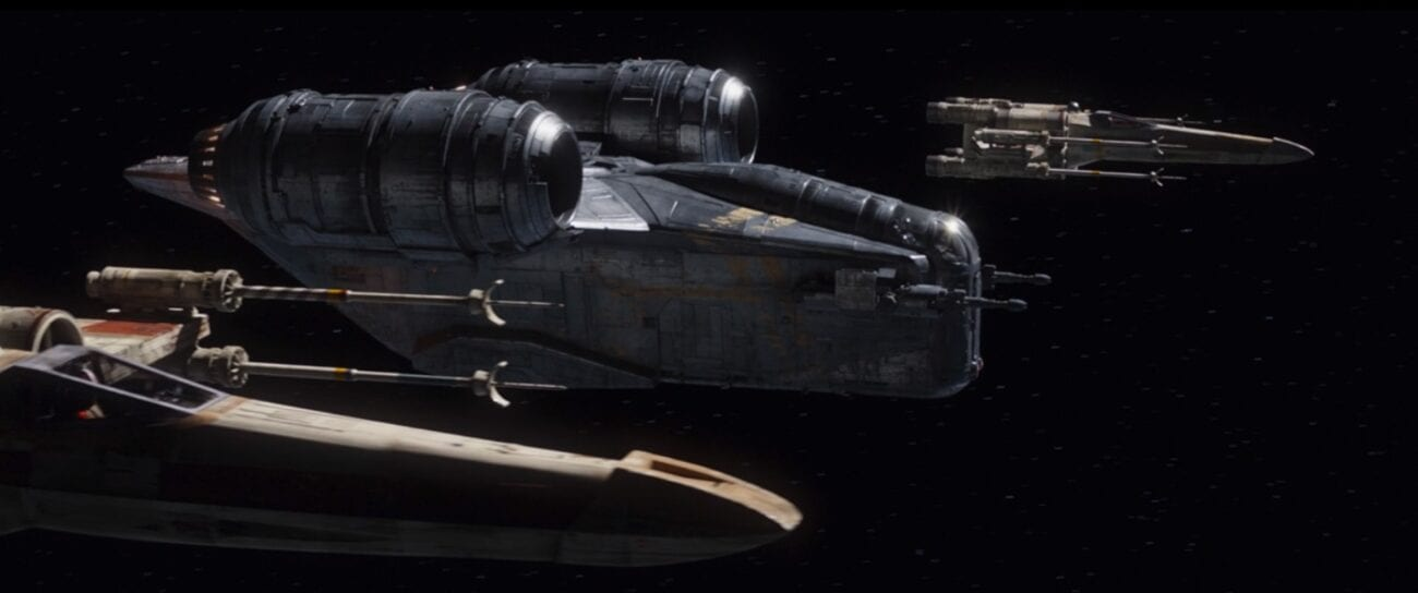 The Razor Crest flies in space, with two X-Wings flanking it
