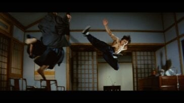 Bruce Lee jumping and kicking in martial arts style
