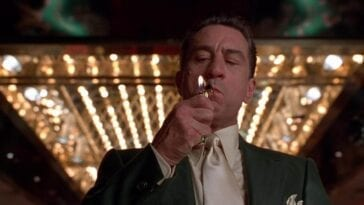 Ace Rothstein lighting a cigarette