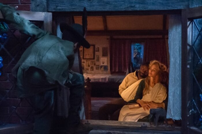 Peter sneaks into a window dressed like Peter Pan while his mother Rose, father David and sister Alice are cuddled up close on a couch