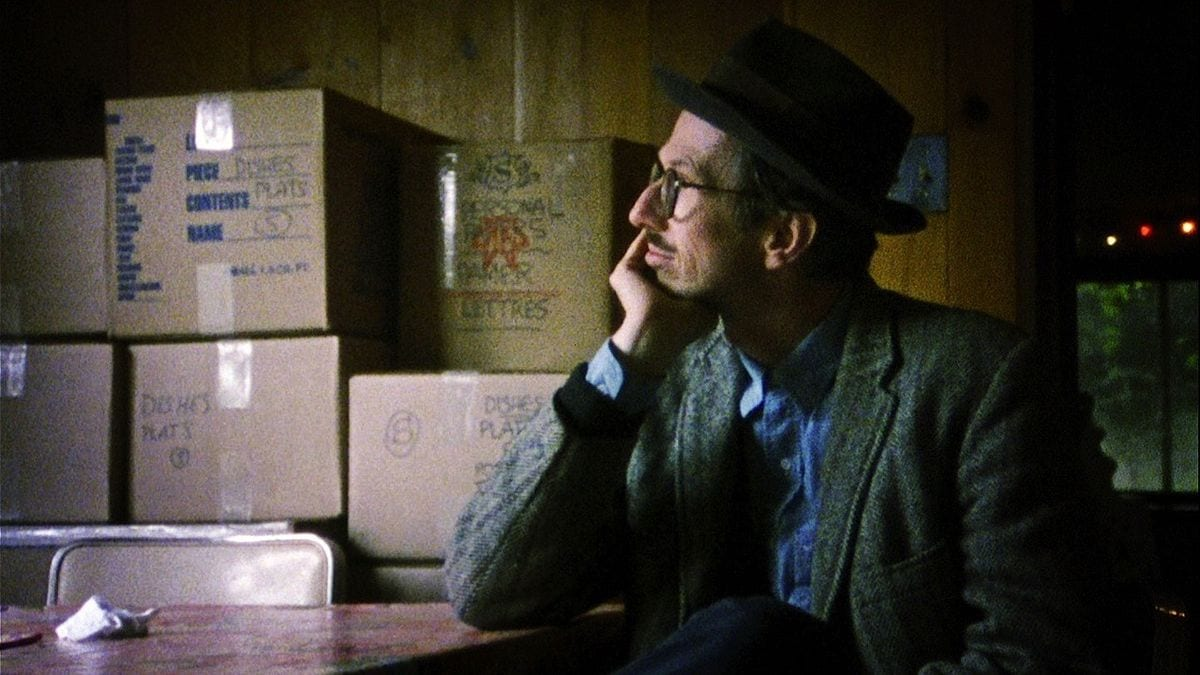 Robert Crumb leaning on a table