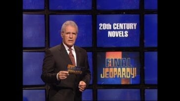 Ale Trebek stands in front of a Final Jeopardy! board with a category that reads 20th Century Novels