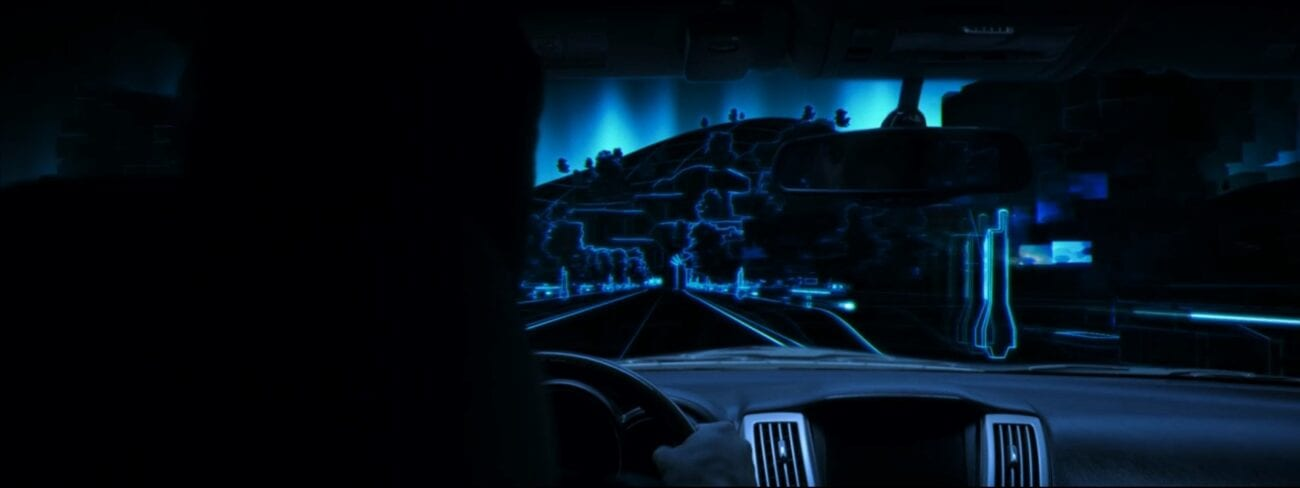 Brendan drives his car through a nighttime scene on a computer generated blue grid