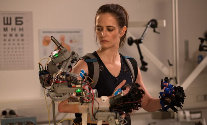 Sarah works with an arm apparatus in astronaut training