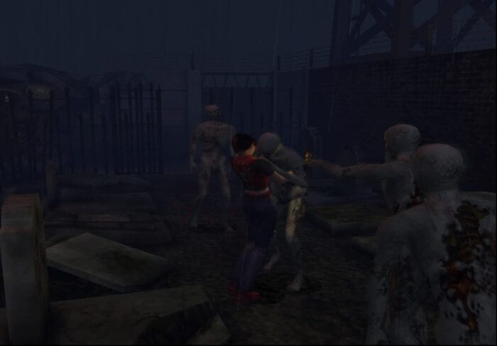 Claire is attacked by Zombies in the Prison Area of the game.