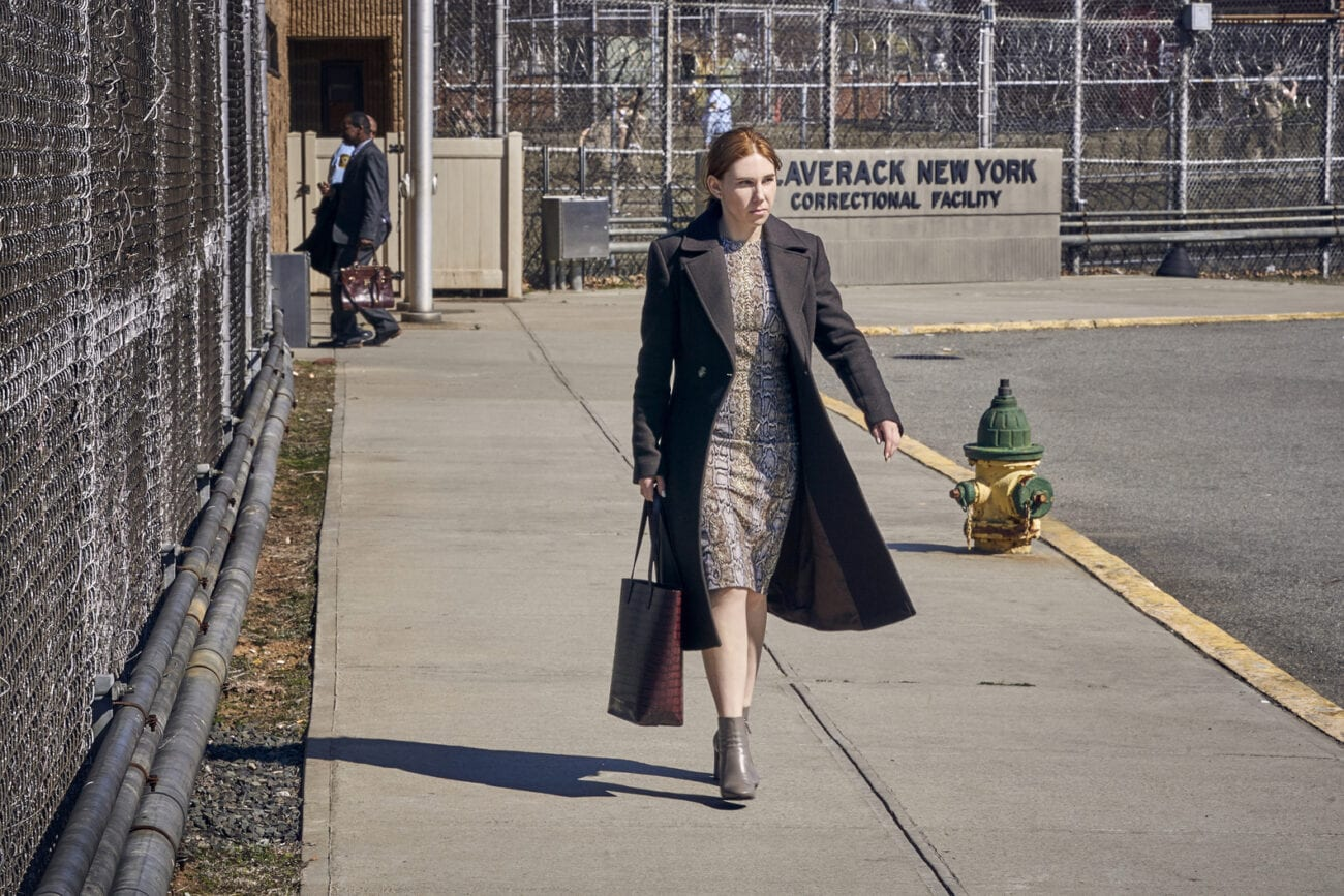 Annie walks out of a correctional facility.