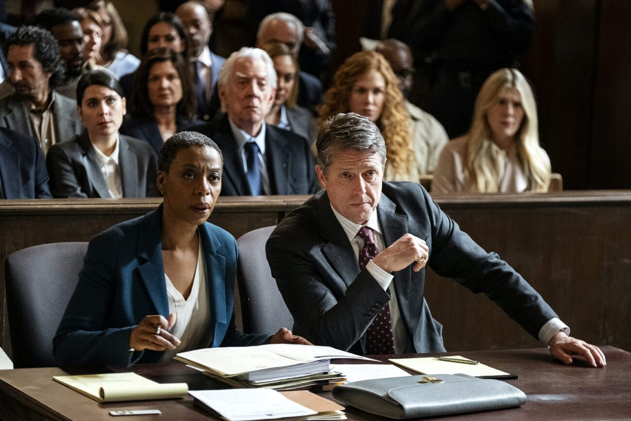 "Haley and Jonathan sit next to each other in court in The Undoing Episode 6 ""The Bloody Truth"""