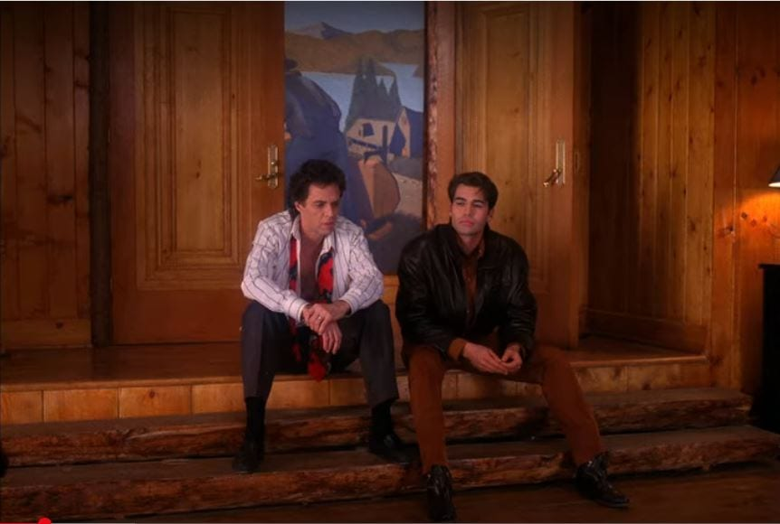 Ben Horne and John Justice Wheeler sit on a step in the Great Northern