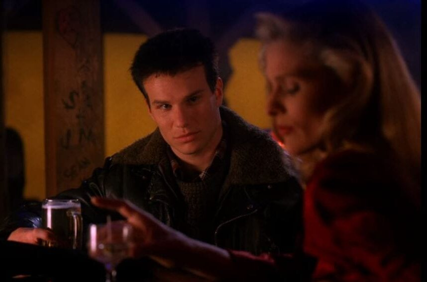 James Hurley looks at Evelyn Marsh as they sit at a bar