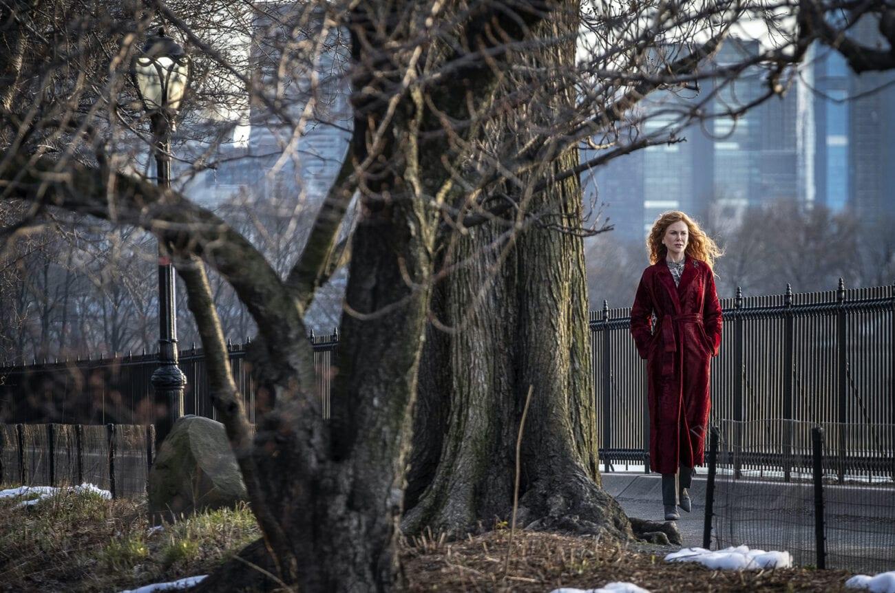 Grace walks by a large tree