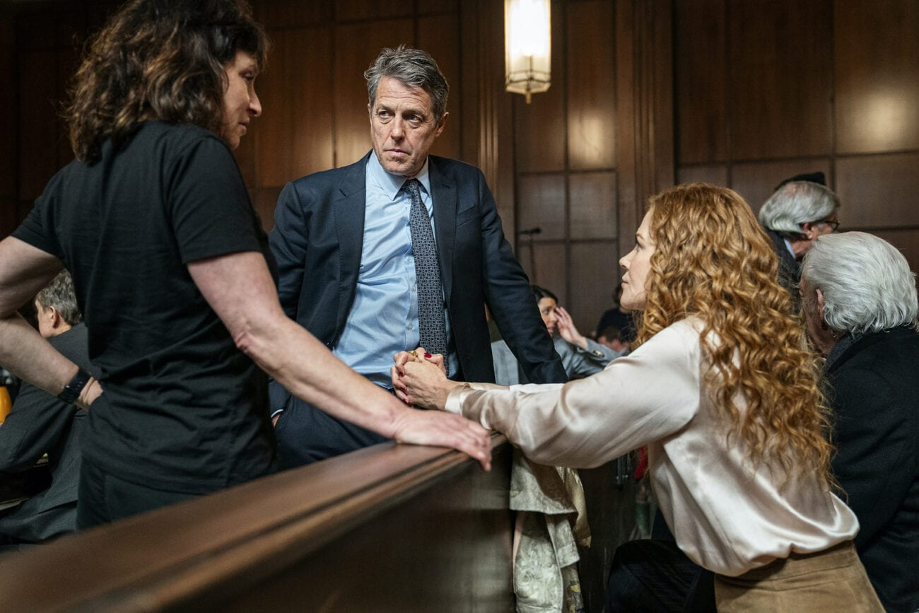 Grace leans towards Jonathan in the courtroom