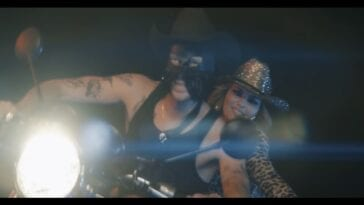 Orville Peck and Shania Twain on a motorbike at night
