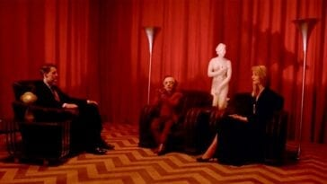Cooper sits in the Red Room for the first time, accompanied on his left by The Little Man and Laura Palmer, sitting on a couch