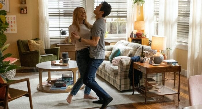 Jennifer and Sol embrace and dance in their living room