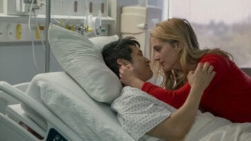 Jennifer lays with her husband Sol on a hospital bed.