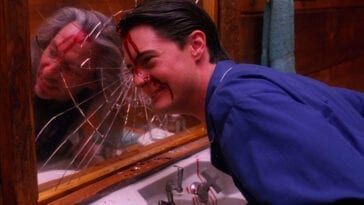 Agent Cooper with BOB in his reflection in the mirror.