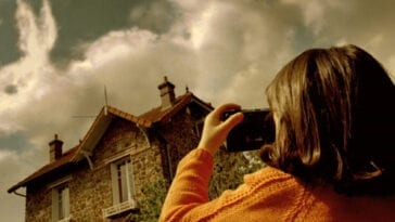 a young girl takes a photo of a cloud that resembles a rabbit