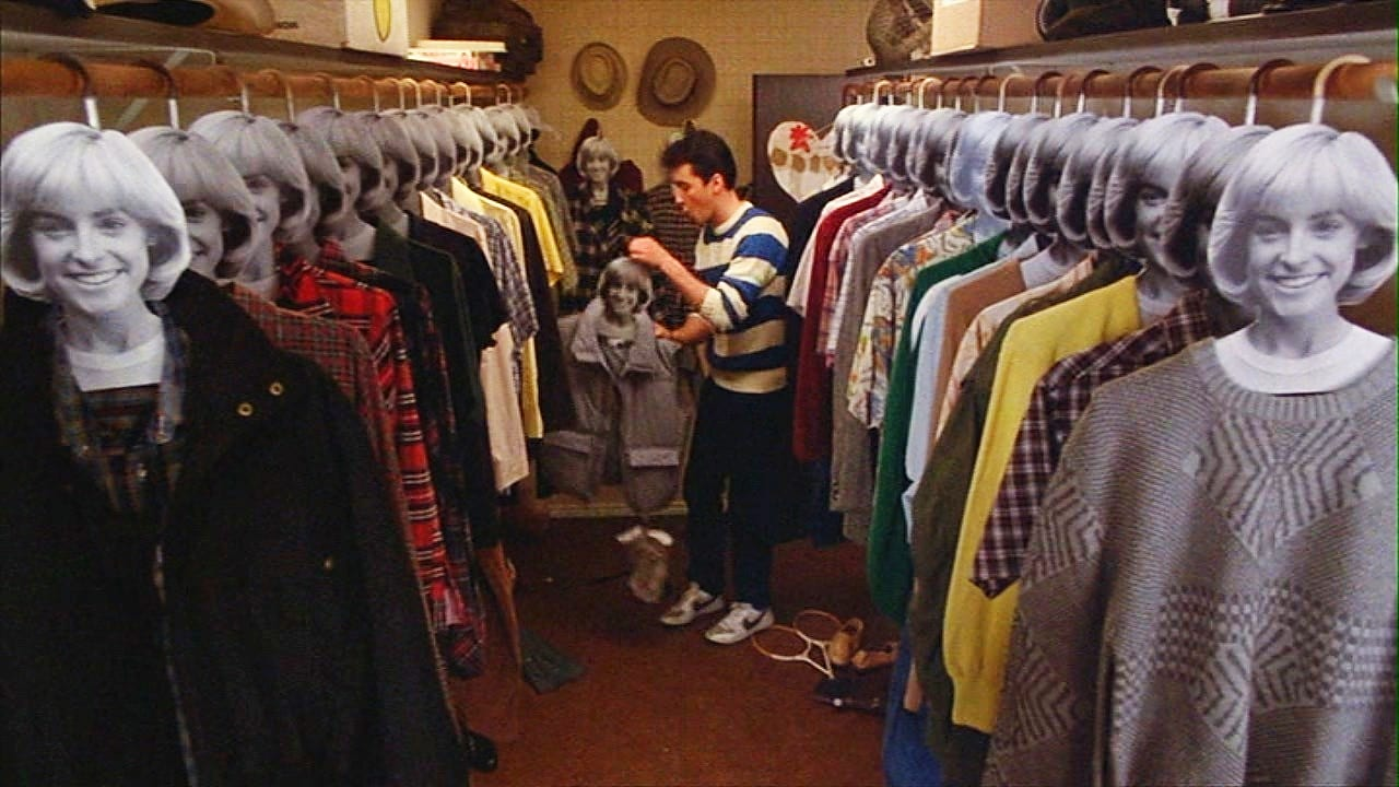 Lane stands in a large closet with images of his girlfriend Beth's face on top of clothes