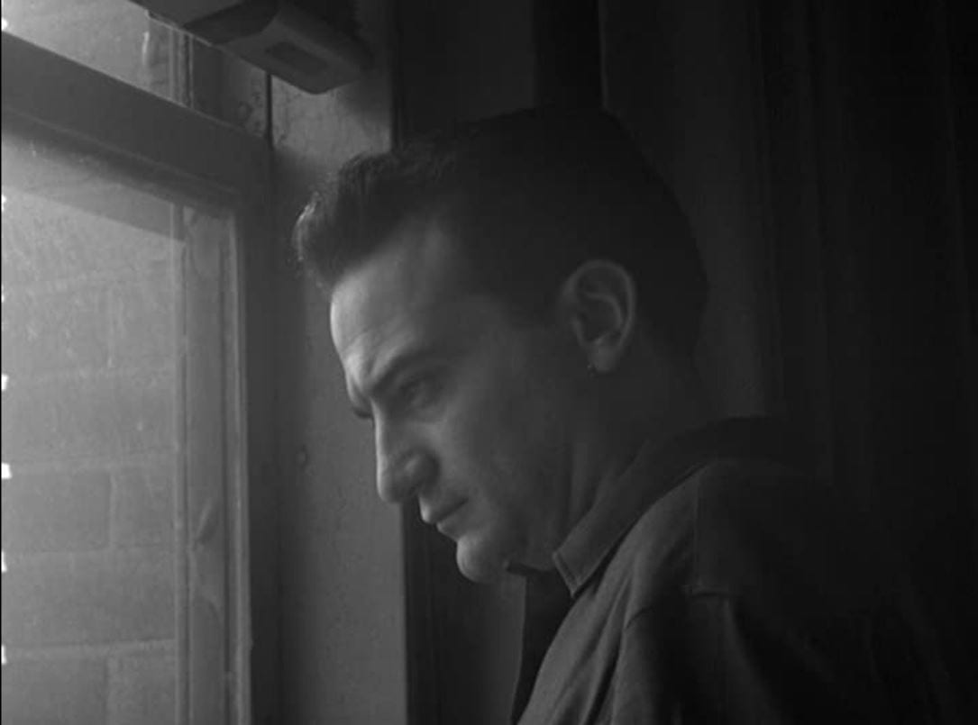 Still from Blast of Silence. Frankie Bono stares pensively out the window.