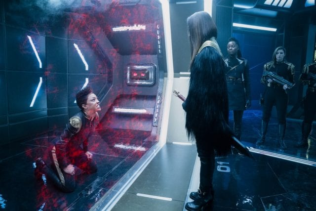 Mirror!Burnham in a cell while Owo and Georgiou look at her
