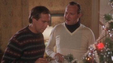 Clark and Eddie standing near the Christmas tree and talking in Christmas Vacation