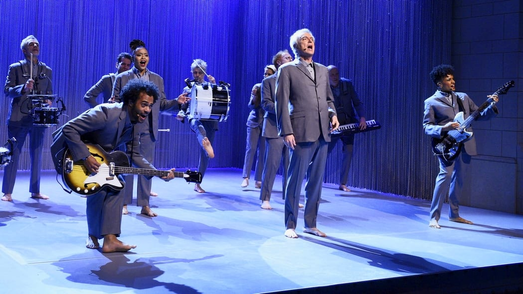 David Byrne and musicians jump up and play onstage