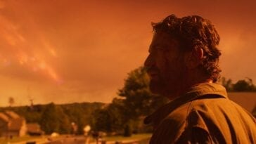 John Garrity looks toward the Orange colored sky as fragments of comet rain down in the background