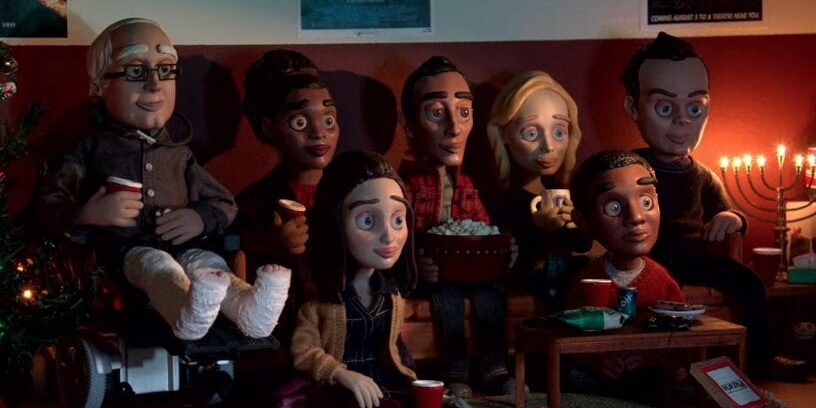 Claymation versions of the Community characters sit and watch TV together