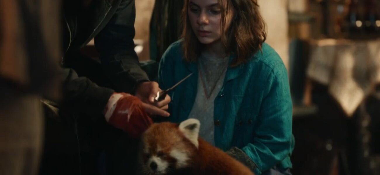 His Dark Materials S2E4 - Pan leans in towards Will's bloody and bandaged hand as Lyra looks on
