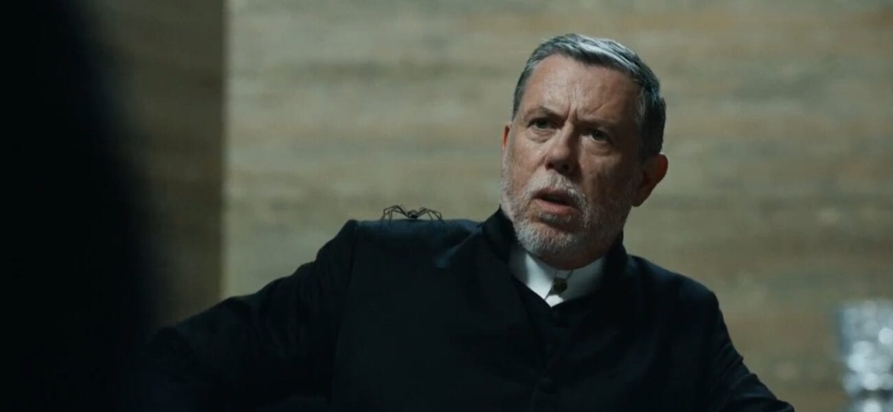 Father Graves looks stunned, his spider daemon on his shoulder