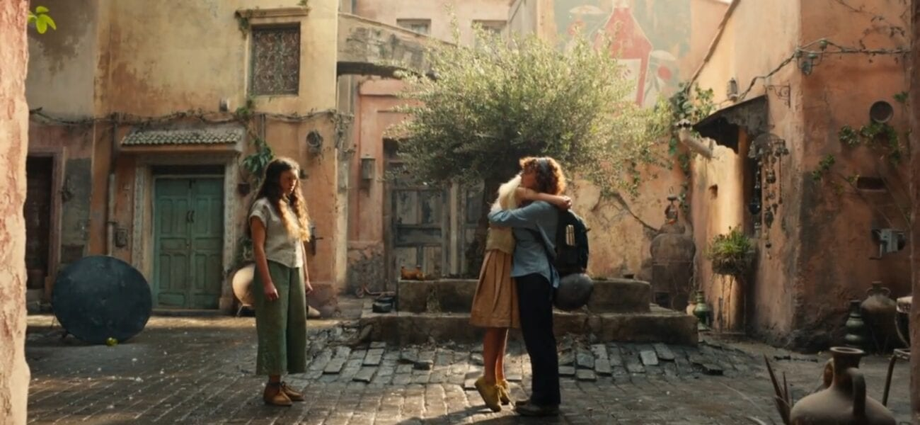 His Dark Materials S2E6 - Mary and Paola hug in front of a fountain, while Angelica watches from the side