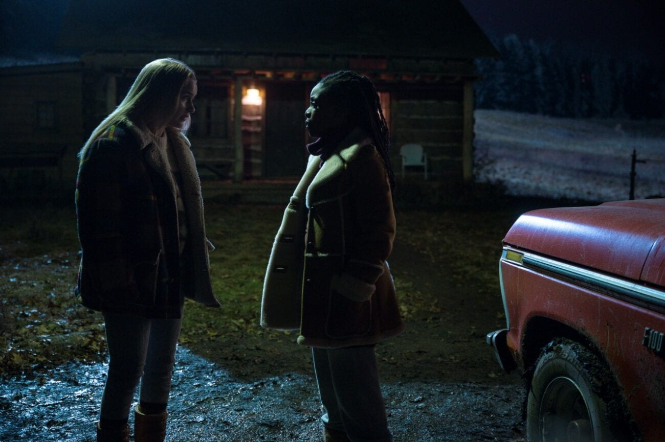 Jean speaks with Teri outside of a cabin in the dark next to a car