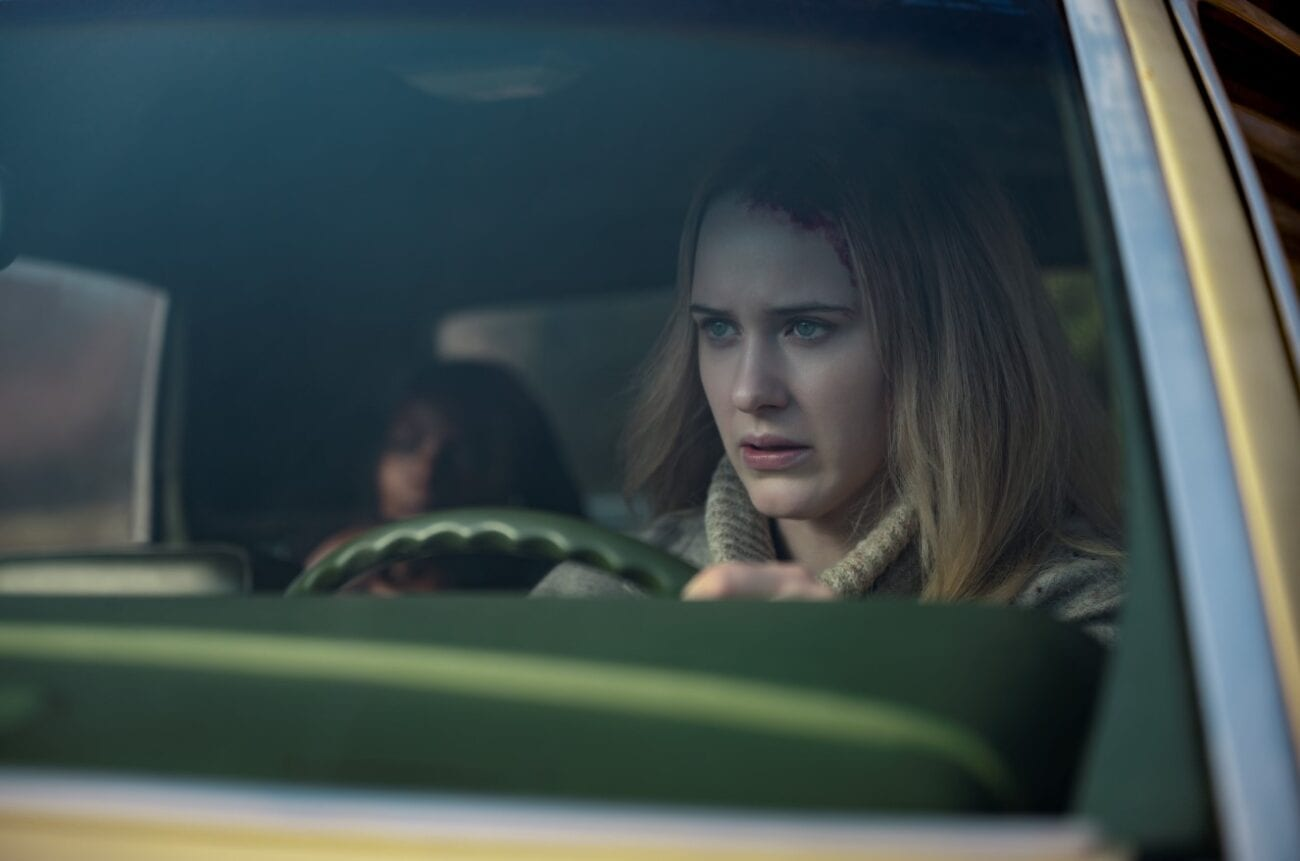 Jean sits behind the wheel of a car with dried blood at her hairline as Teri lay out of focus in the back seat