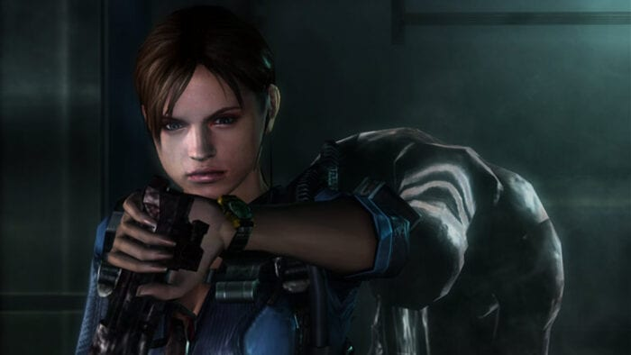 Jill finds a gun as an Ooze drops down behind her in Resident Evil Revelations.