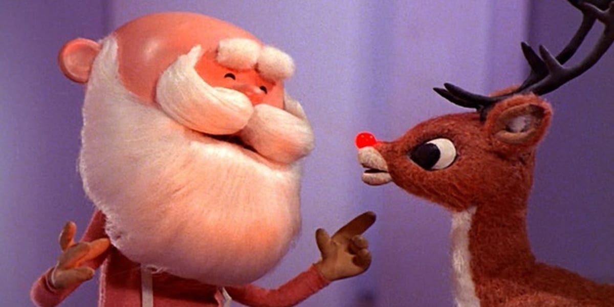 Rudolph with Santa, Santa smiling and motioning to Rudolph in Rudolph the Red Nosed Reindeer