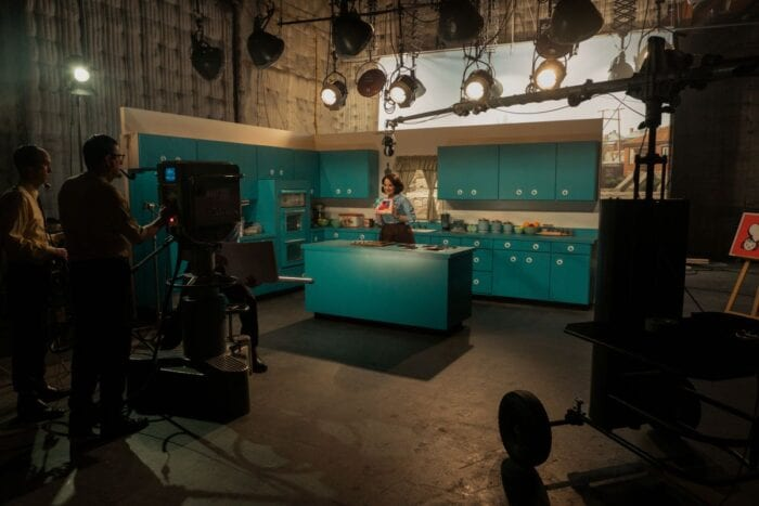 Lucy is seen in production hosting the cooking show.