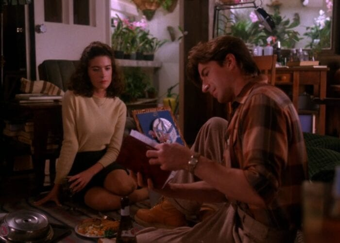 Harold Smith reads to Donna from Laura Palmer's secret diary, his greenhouse full of orchids visible in the background.