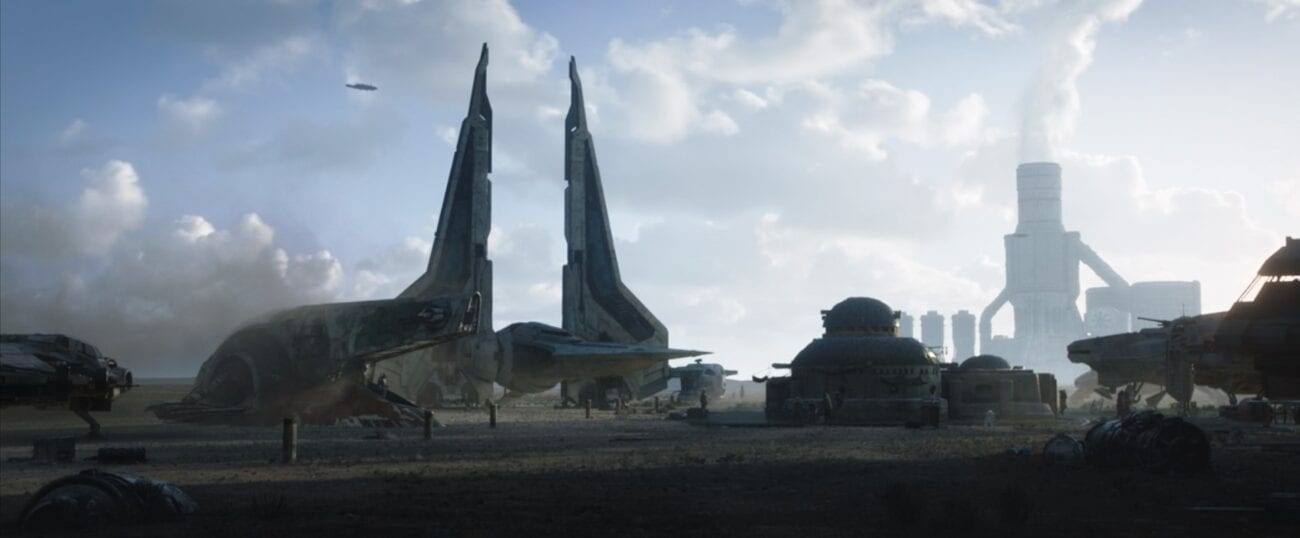Slave 1 parked next to a Mandalorian gauntlet fighter, which has its wings pointed up