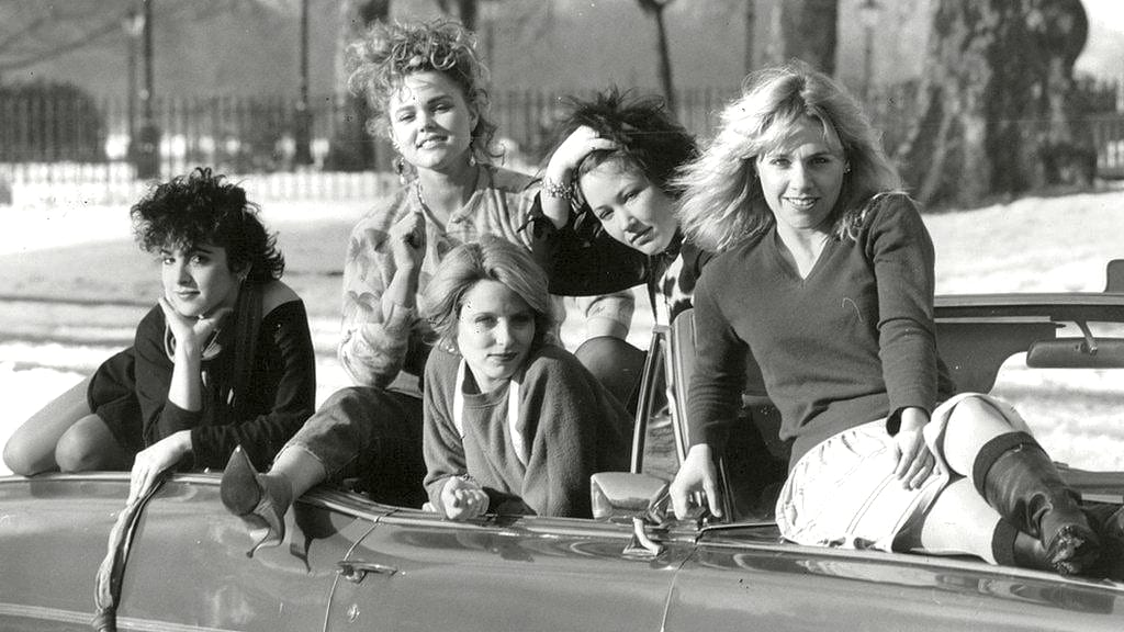 The Go-Go's pose inside a cadillac
