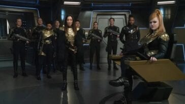"Georgiou (Michelle Yeoh) stands at attention with the rest of the Mirror Universe crew while Captain ""Killy"" (Mary Wiseman) sits in the captain's chair"
