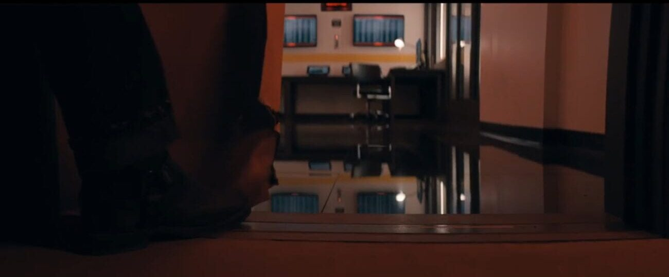The Stand S1E1 - A boot holds a sliding door open, some sort of control center in the room beyond it