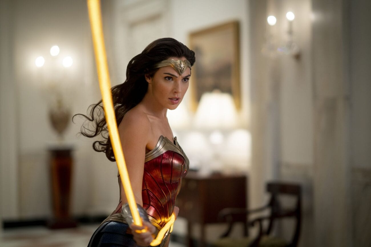 Wonder Woman twirls her lasso down a White House hallway.