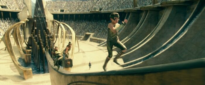 A young Diana scales a ramp in an arena.